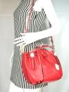 Charles & Keith กระเป๋าถือ/สะพาย ทรงขนมจีบ (bucket) หนังสีแดง size M